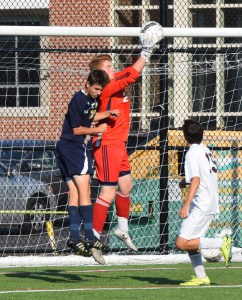 Pottsgrove goalkeeper Liam Abdalla leaps to catch the ball over Spring-Ford's Mike Hyduke Friday. (Austin Hertzog - Digital First Media)