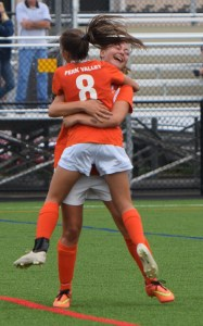 Perkiomen Valley's Maggie Sell, facing, gets a hug from teammate Samantha Penny after scoring a goal from 25 yards out in the second half Monday against Pottsgrove. (Austin Hertzog - Digital First Media)