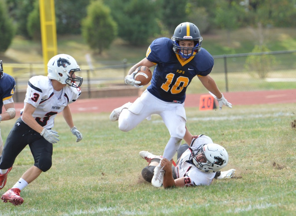 Pope John Paul II's Brandon Knox breaks a tackle during the Golden Panthers' 33-0 victory over Schuylkill Valley. (Sam Stewart - Digital First Media)