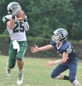 Methacton receiver Ryan O'Toole (25) hauls in a reception while Pottstown's Nate Parson comes in for the hit. (Barry Taglieber - For Digital First Media)