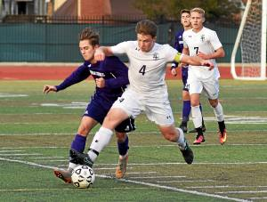 LaSalle's Joseph Puck and Roman's Seth Stangler battle for a loose ball on Saturday in the PCL Championship.