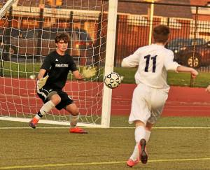 Roman's freshman goalkeeper Kevin Tobin makes a save as La Salle applies the pressure on Saturday.