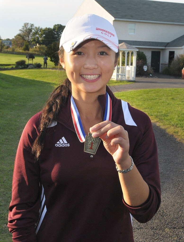 Top photo, Conestoga's Samantha Yao watches her drive during the District 1 Championships at Turtle Creek Golf Club in Limerick October 11, 2016. Here, Yao poses with her first-place medal. (Photo by Gene Walsh - Digital First Media)