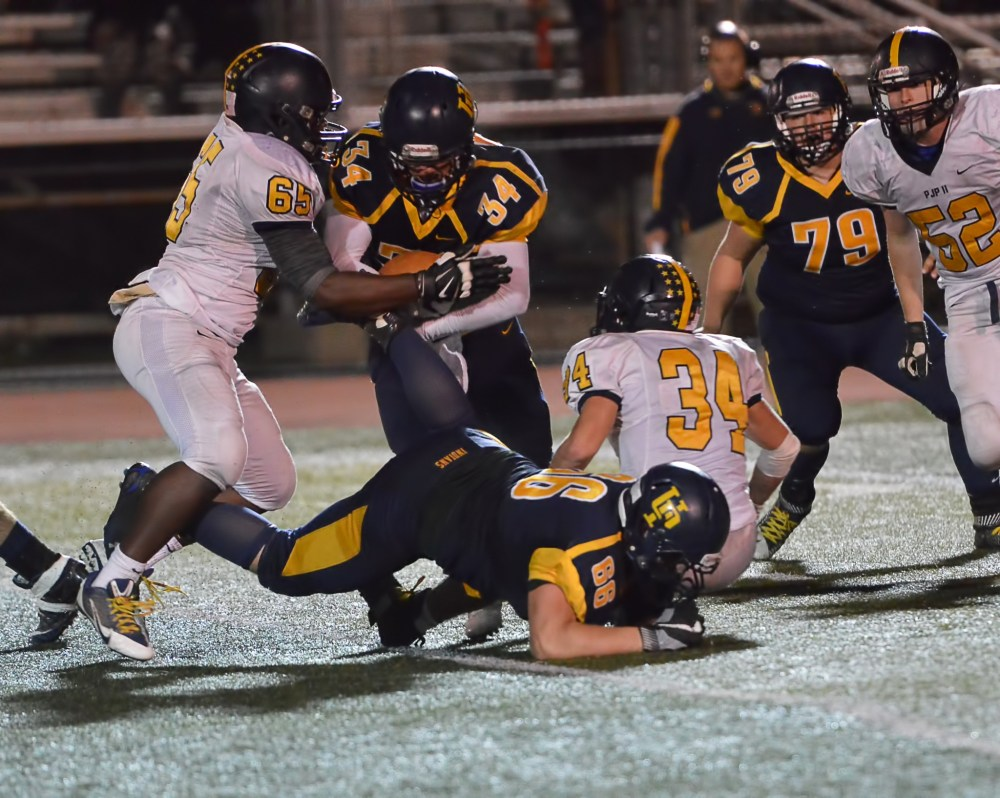 Upper Perkiomen running back Tyler Whary (34) fights for more yardage during the first half. (Sam Stewart - Digital First Media)
