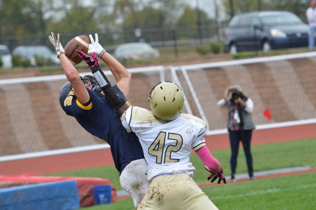 Upper Merion's Taiyan Lobban knocks the ball free from the hands of Ryan Kormos in the end zone. (Sam Stewart - Digital First Media)