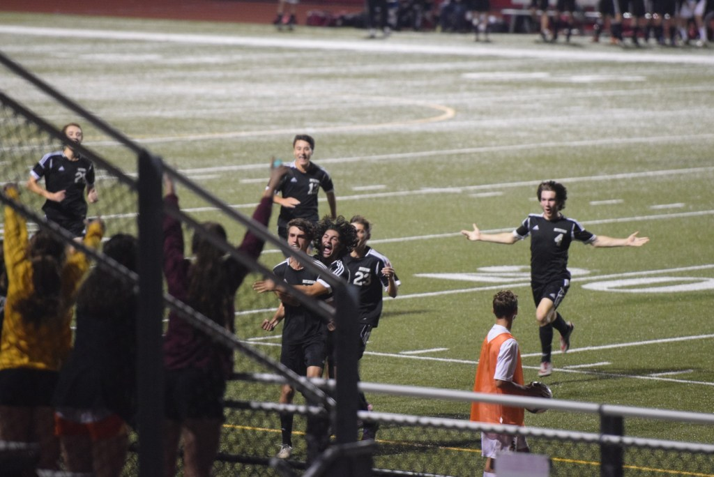 Erik Recke, center left, and Nik Verma lead the celebration in front of the Boyertown fans after Recke scored the game-winning goal of the Bears' semifinal win over Spring-Ford Tuesday. (Austin Hertzog - Digital First Media)