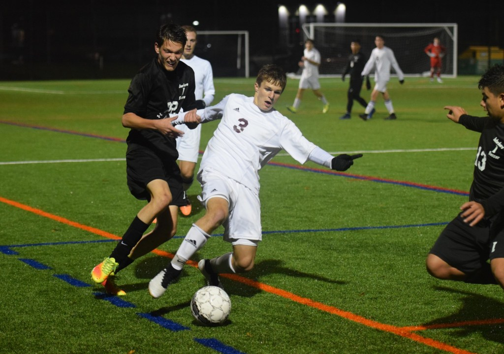 Pottsgrove's Tyler Rolando (3) plays the ball along the sideline against the pressure of Interboro's Joey Pitts during their 1-AAA boys soccer playoff game Thursday. (Austin Hertzog - Digital First Media)