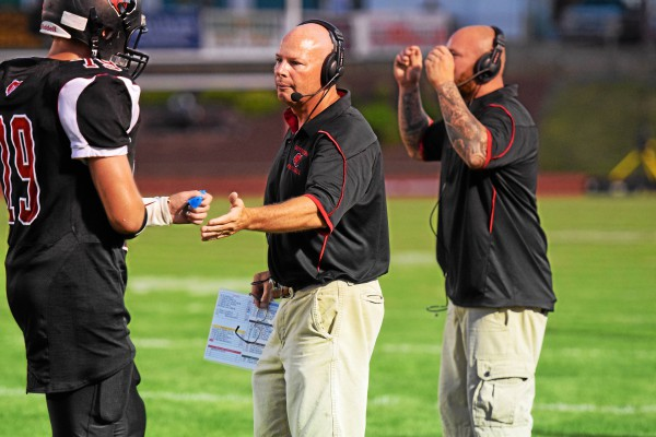 George Parkinson, middle, stepped down from his position as Boyertown head coach Saturday following the Bears' 21-14 win over Pottstown to end the season. (DFM file photo)