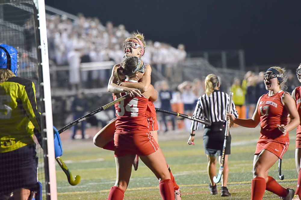 Owen J. Roberts' Leanne Faust, up, jumps into the arms of Natalie Fuertsch (34) after Fuertsch scored the Wildcats' opening goal on a penalty stroke during the PAC Championship. (Sam Stewart - Digital First Media)