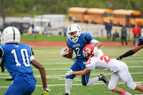 Norristown's Shannon Carnard carries the ball against Owen J. Roberts Saturday. (Jeff Davis - For Digital First Media)