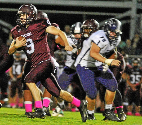 Pottsgrove's Ryan Finn rushes past Phoenixville's Matt Valdovinos on a carry Friday. (Barry Taglieber - For Digital First Media)