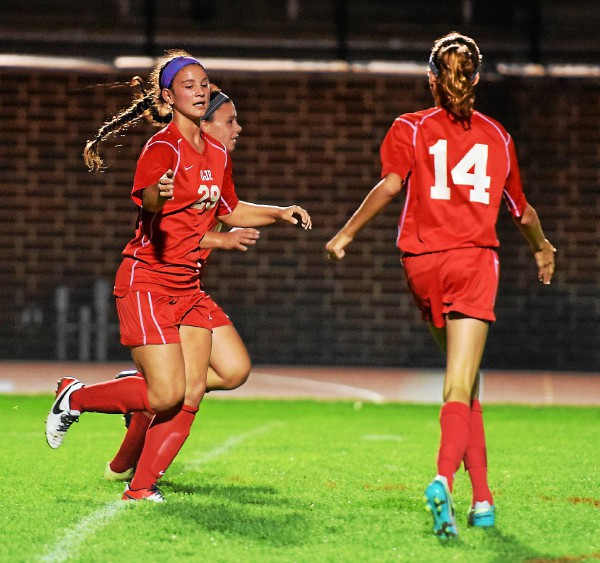 Owen J. Roberts' Kylie Cahill, left, and Kenzie Milne (14) congratulate one another after Cahill headed in Milne's corner kick in the first half Thursday against Boyertown. (Austin Hertzog - Digital First Media)