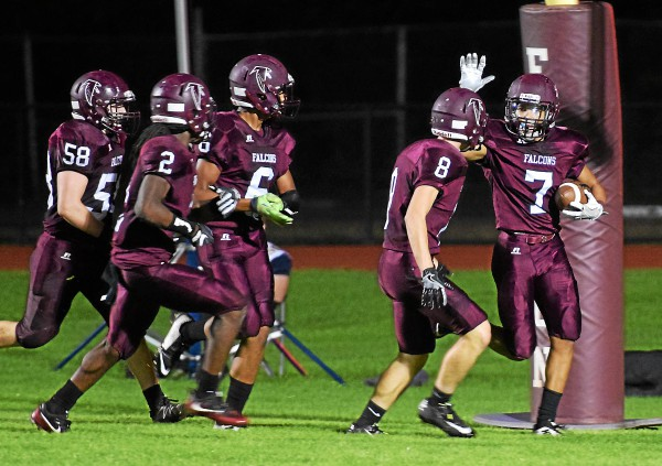 Pottsgrove's Kobey Baldwin (7) is congratulated by Adam Girafalco (8) and other teammates after his 38-yard touchdown run in the second quarter against Upper Perkiomen. (Austin Hertzog - Digital First Media)