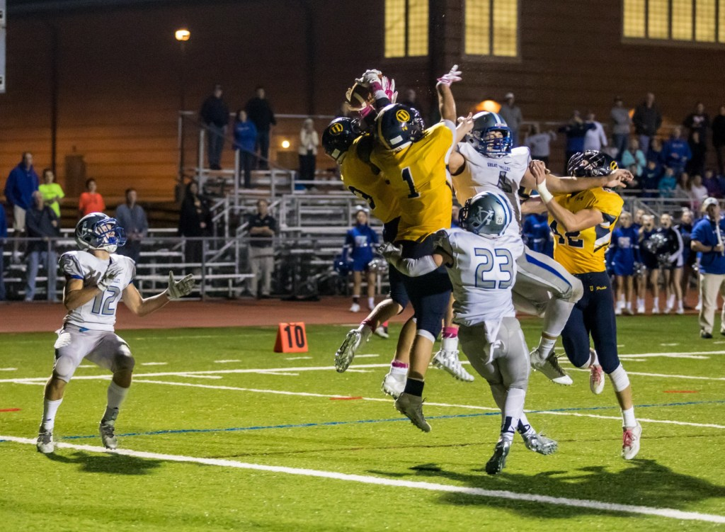 Unionville's JT Hower picks off the final pass of the game to seal the 16-13 win. (Nate Heckenberger - For Digital First Media).