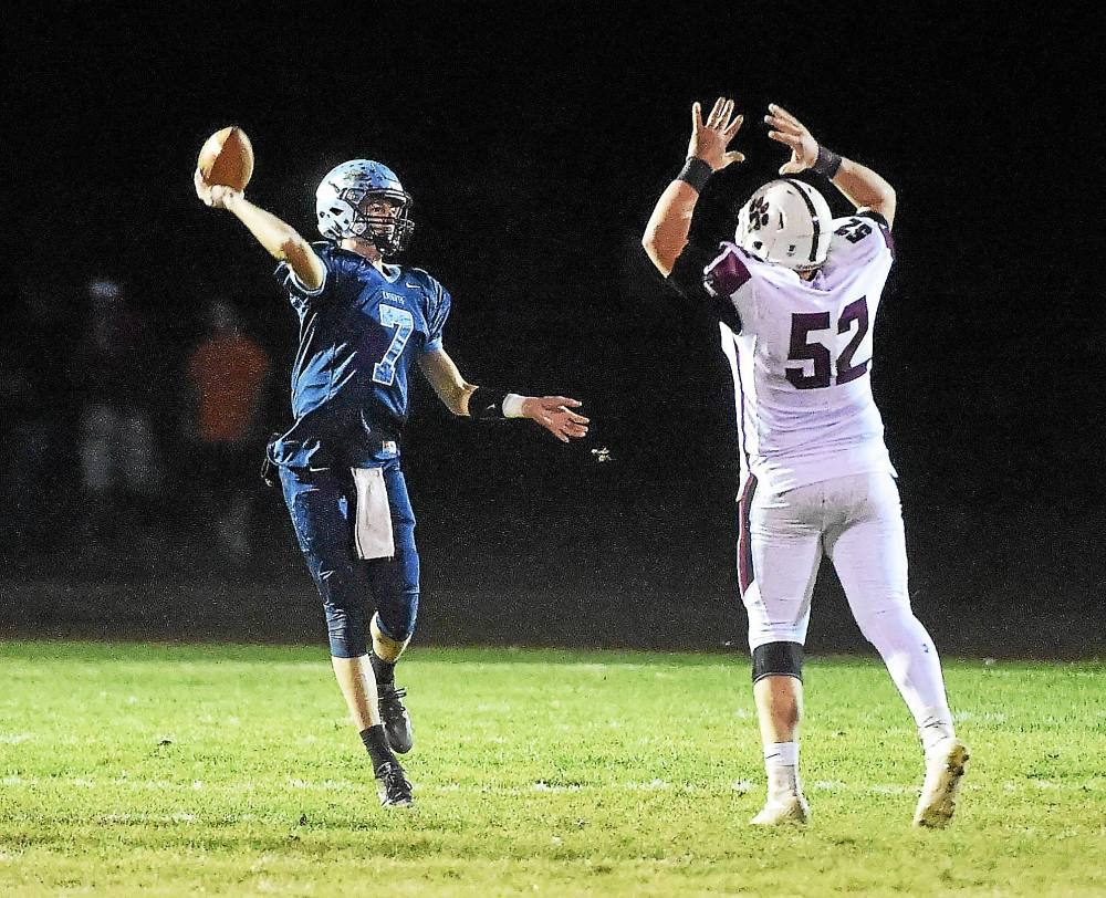 PETE BANNAN-DIGITAL FIRST MEDIA North Penn Knights #7 Reece dinski throws a pass over Garnet Valley defender Shane Donegan in the first half of the District one final against Garnet Valley at Crawford stadium Friday evening.