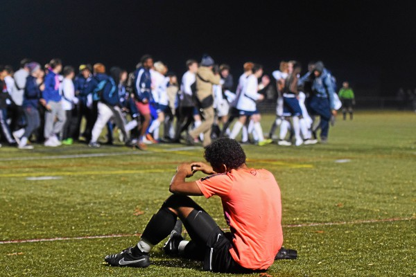 Penn Charter goalkeeper Jay Jennings sits on the turf while the Hill celebrates. (Austin Hertzog - Digital First Media)