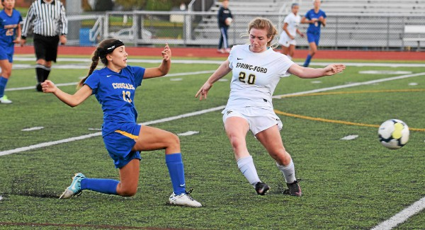 Downingtown East's Jayna Schack clears the ball as Spring-Ford's Gabby Kane presses. (Austin Hertzog - Digital First Media)