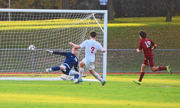 Holy Ghost Prep's Brendan Eagen scoring the winning goal past Pottsgrove goalkeeper Liam Abdalla during their District 1-AAA boys soccer semifinal Wednesday. (Austin Hertzog - Digital First Media)