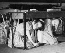 Children Kneel Under Desks During Air Raid Drill