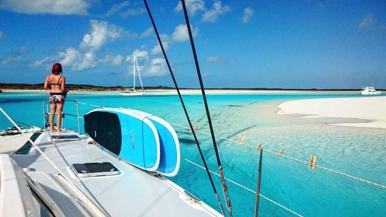 paddle board on the catamaran in the exuma
