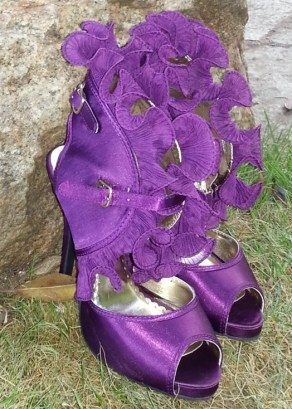 The bride's purple, ruffled shoes