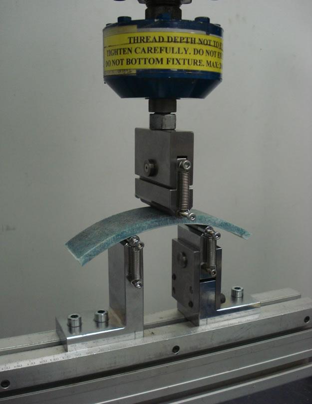 ISO 11296 flexural property test fixture setup.