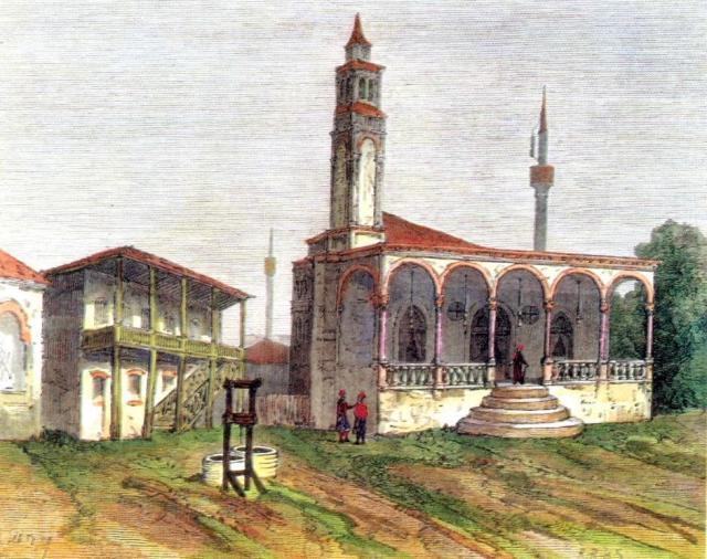 Το Σαατλή τζαμί με τον μιναρέ του και τον πύργο του ρολογιού.