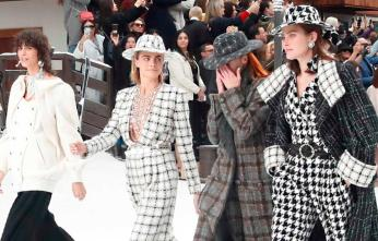 Model Cara Delevingne, second from left, walks the runway with other models as they wear creations as part of the Chanel ready to wear Fall-Winter 2019-2020 collection, that was presented in Paris, Tuesday, March 5, 2019. (AP Photo/Thibault Camus)