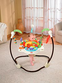 baby jumping in a stationary activity jumper