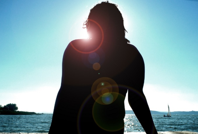 woman-beach-sun-health