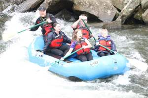 My family rafting with SOAR.