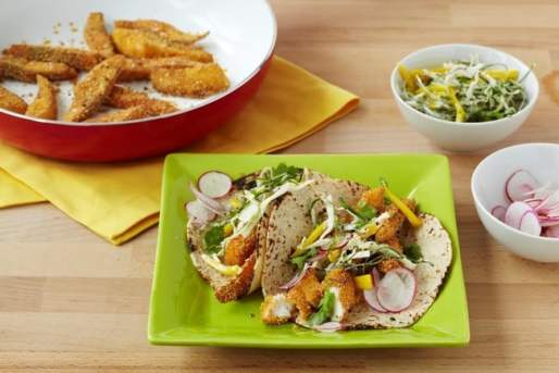 Polenta-Crusted Fish Tacos with Spicy Mango Slaw