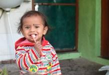 Indian baby brushing eeth