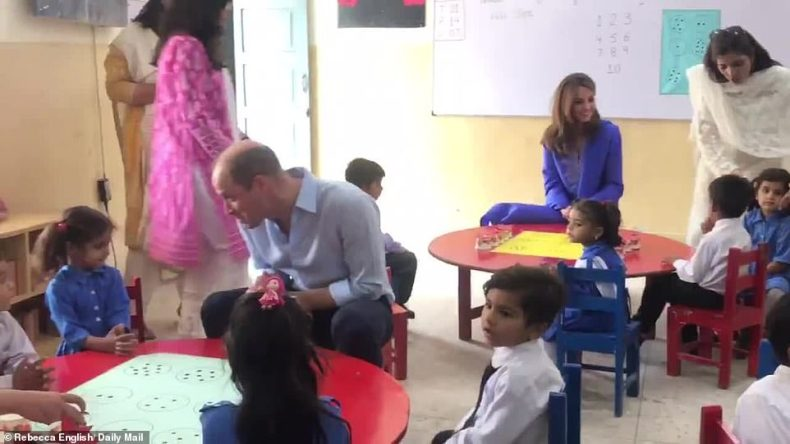 Pleased to meet you: William sat at the children's table to talk to girls and boys at the school in central Islamabad