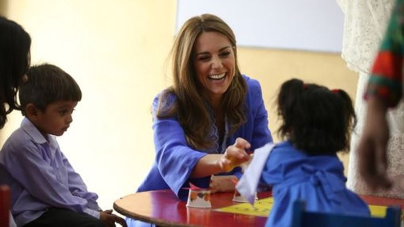 Natural: Kate looked happy and relaxed as she chatted to children in the classroom. Her own children are at school in London