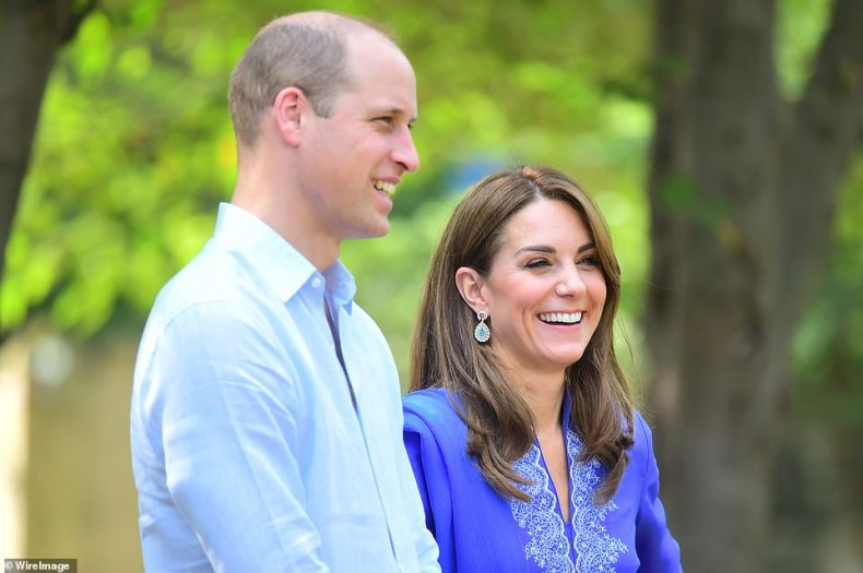 Having a blast: Kate cracks a huge smile as her and William arrive at the national park, with Kate still sporting her stunning traditional blue kurta and scarf and pair of blue earrings