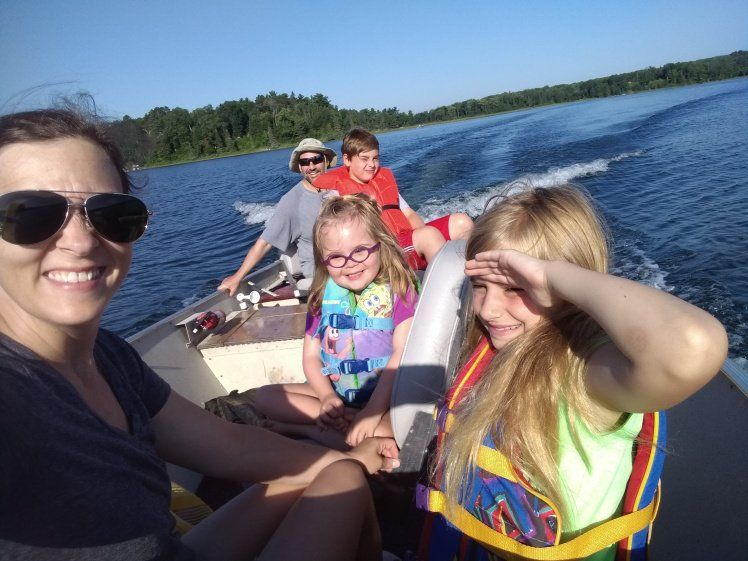 Willow riding in a boat with her family.