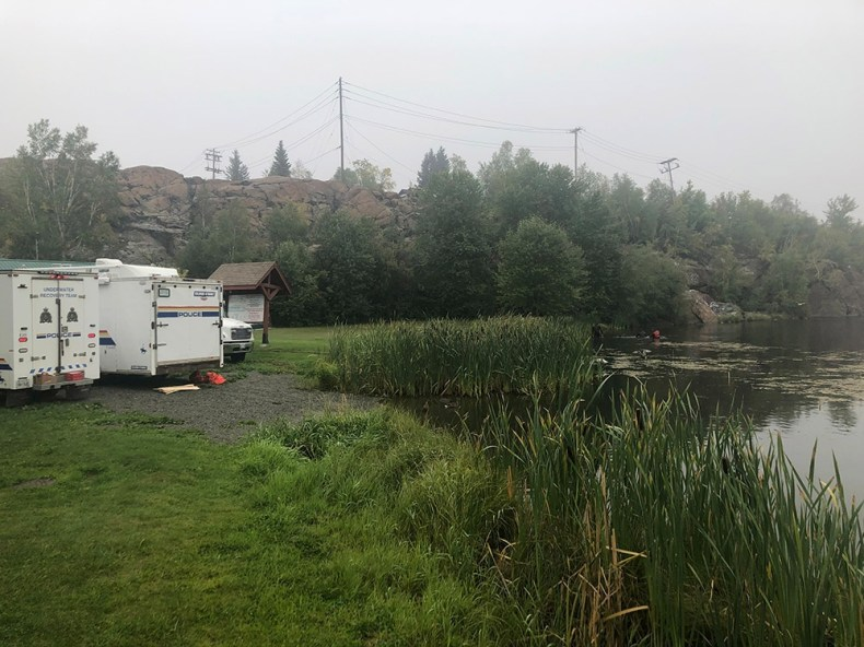 RCMP divers searched Hapnot Lake.