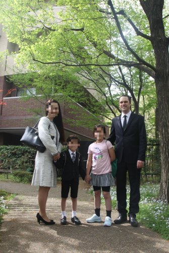 Scott McIntyre with his wife, Naoko, and their two children in happier times. He has not seen his kids since last May, when they went to stay with their Japanese grandparents for a night and never returned.