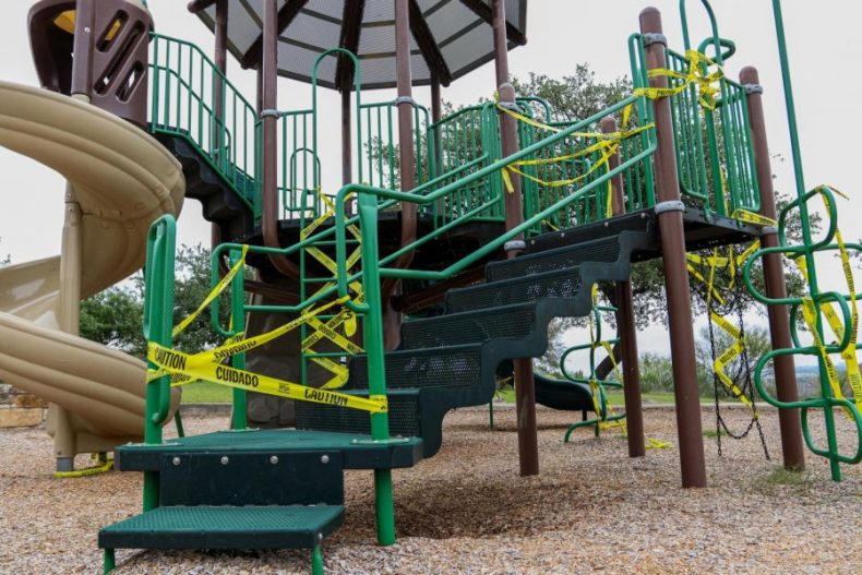 The+once+filled+playground+now+sits+empty+and+guarded+by+caution+tape%2C+Saturday%2C+April+18%2C+2020%2C+in+the+Grandview+neighborhood+in+San+Antonio%2C+Texas.+Playgrounds+throughout+the+city+are+being+left+silent+and+empty+while+kids+are+forced+to+stay+inside+due+to+the+Stay+at+Home+order.