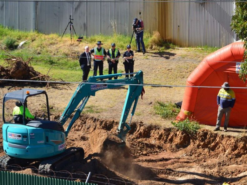 An excavator digs up an area of the New Castalloy site in Adelaide's North Plympton in a new search for the Beaumont children