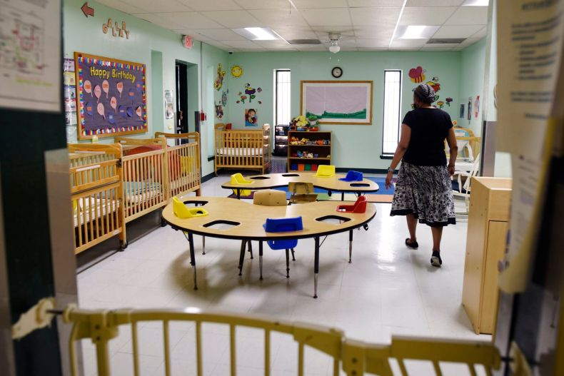 Dr. Ora Watson, owner and director of For Keeps Sake Child Care Academy, walks through an empty infant classroom at her child care academy in Dallas. On Tuesday the academy had one infant; before the pandemic the infant room catered to 10 kids a day.
