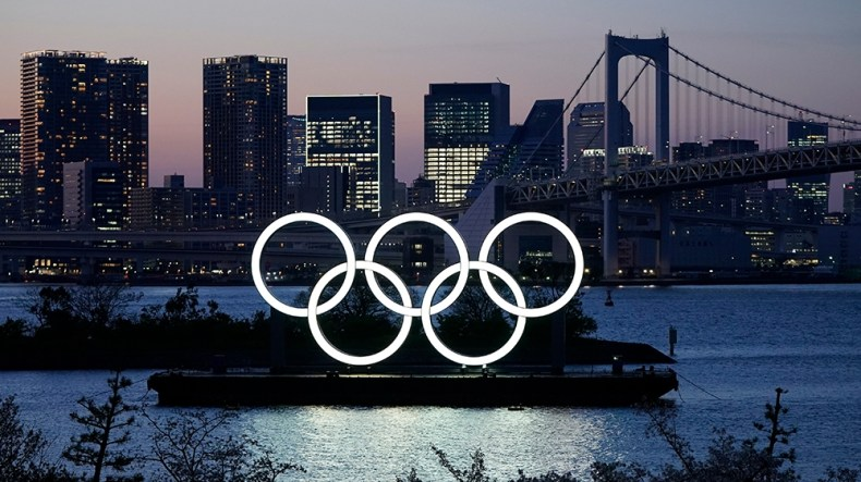 epa08389035 (FILE) - A giant Olympic rings monument is illuminated at dusk at Odaiba Marine Park in Tokyo, Japan, 25 March 2020 (issued 28 April 2020). According to local media reports, during an inte