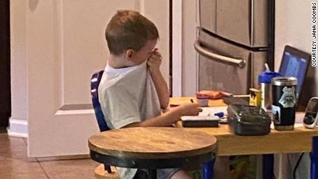 A mother captured an emotional photo of her son crying in virtual class to show difficulties of distance learning during pandemic