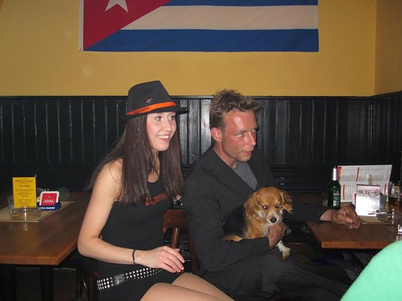 Locals in Praia de Luz said German paedophile Christian Brueckner, pictured holding a dog in a bar in Hanover, Germany in 2011, dated a string of women while living in Portugal
