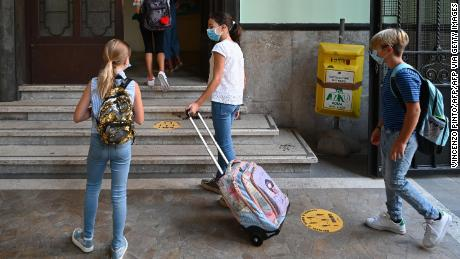 The masked students arrive at the Luigi Inadi Technical High School in Rome, Italy on September 14 to begin the school year.