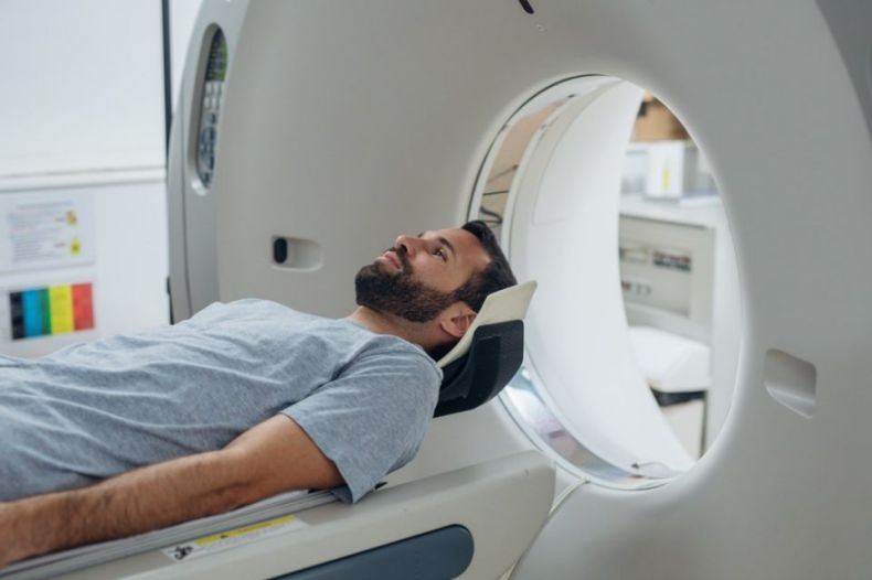 Patient lying on the TC scanner bed waiting to be scanned