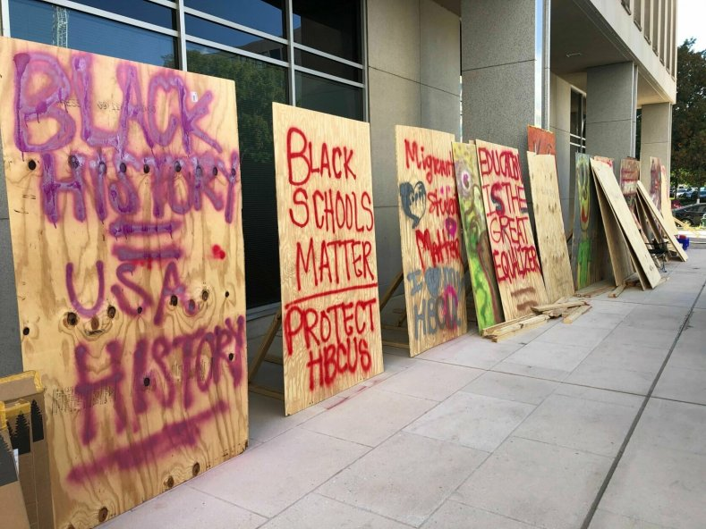 The art for the protest has been put on display by demonstrators who say they will occupy the area outside the Department of Education building in D.C. until their demands are met.