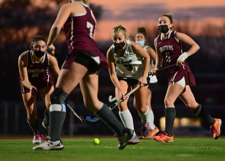 Shenendehowa's Julie Kuzmich is surrounded by Burnt Hills players as she take the ball down the field during the Suburban Council field hockey final on Friday, Nov. 20, 2020 in Clifton Park, N.Y. (Lori Van Buren/Times Union)