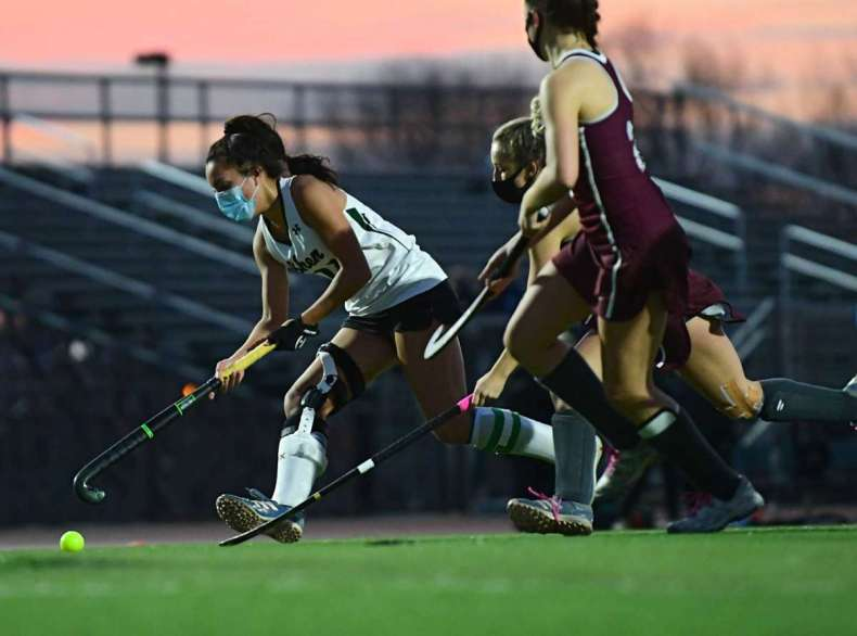 Shenendehowa's Rachel Sterle, left, takes the ball down the field against Burnt Hills in the Suburban Council field hockey final on Friday, Nov. 20, 2020 in Clifton Park, N.Y. (Lori Van Buren/Times Union)